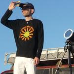 Lica Quaglia eclipse scientist looking through eclipse glasses